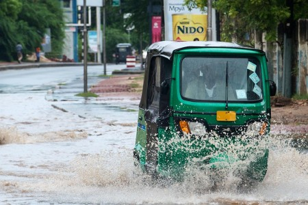 A bajaj drives along UN Road. Photo: Daniel Hayduk