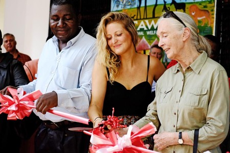 TAWESO Director Brittany Hilton and Dr. Jane Goodall cut the ribbon as Executive Director Thomas Kahema looks on, at left. Photo: Daniel Hayduk
