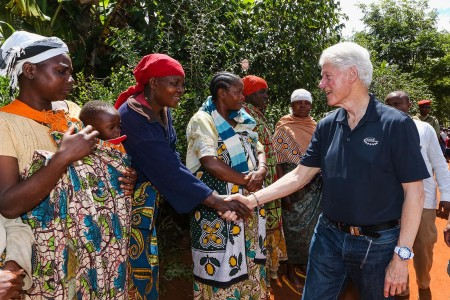 Former US President Bill Clinton greets smallholder farmers in the Lugalo Village on Wednesday. Photo: Clinton Foundation