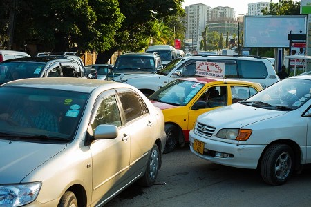 How many turn lanes? Locals act out one of Dar's daily rituals, the traffic jam. Photo: Daniel Hayduk