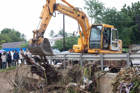 Cleanup crews tackle debris at Mbezi Beach on Friday.  Photo contributed: Abigail Snyder.
