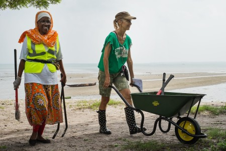 Dozens of volunteers have been working to clean and now landscape Msasani beach. Photo: Daniel Hayduk