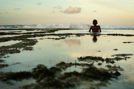 A child watches waves at Coco beach. Photo: Daniel Hayduk