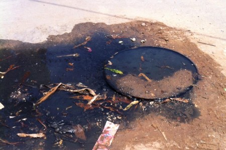 An overflowing sewer in Upanga. The current cholera outbreak has now claimed at least 68 lives. Photo: Daniel Hayduk