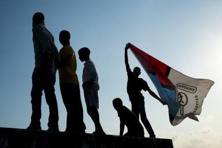 A man flies a Chadema flag upside-down at a rally earlier this month. Photo: Daniel Hayduk