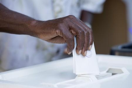 A man casts his ballot. Photo: Daniel Hayduk