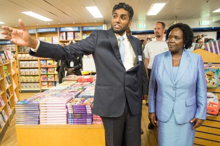 Logos Hope Director Seelan Govender shows Minister of Education Joyce Ndalichako around the floating book fair. Photo: Daniel Hayduk