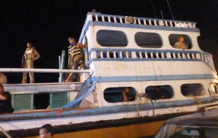 Troops inspect the Iranian vessel believed to be headed to Tanzania loaded with 100kg of drugs. Photo: NDEA handout