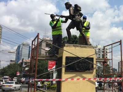 Crews work on restoring the Askari monument, which was repainted without permission during last year's Independence Day cleanup. Photo: Daniel Hayduk